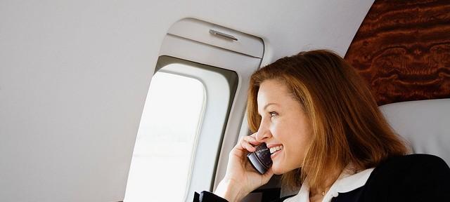 travel-woman-airplane-happy