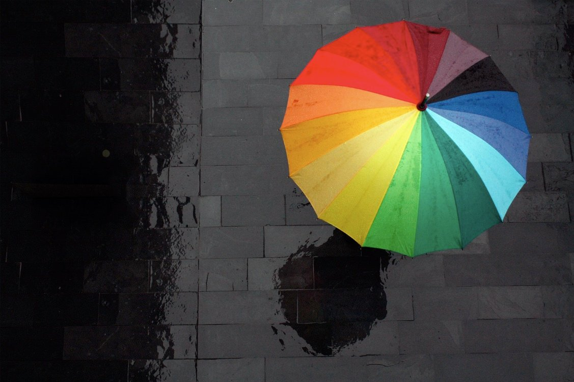 colourful-umbrella-tax-shelter-storm