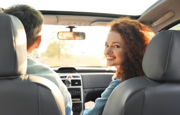 who-can-drive-my-car-under-my-insurance-in-ontario-couple-in-car-woman-looking-back