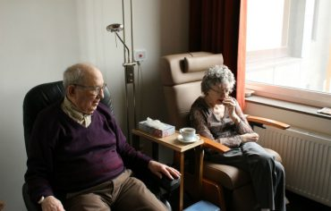 An old couple contemplating selling their life insurance