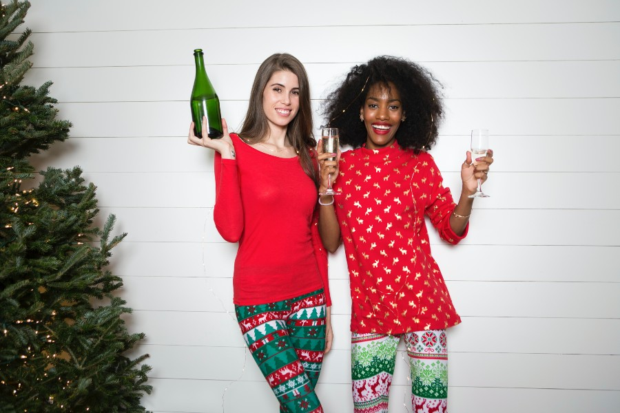 holiday-house-insurance-women-smiling-tree-wine