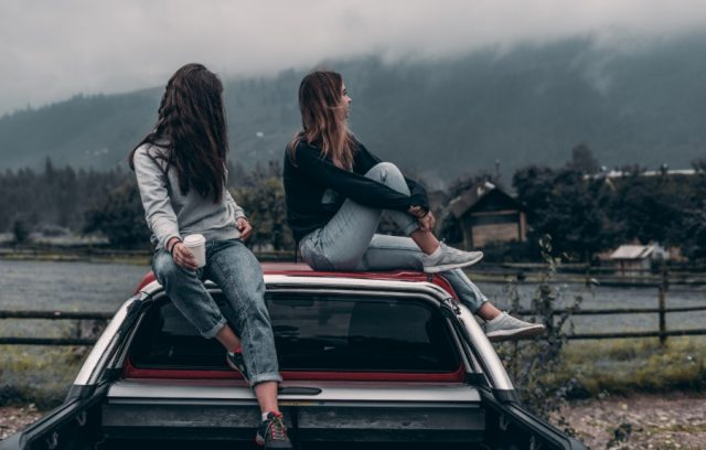 car-insurance-fraud-2-women-sitting-on-top-of-truck