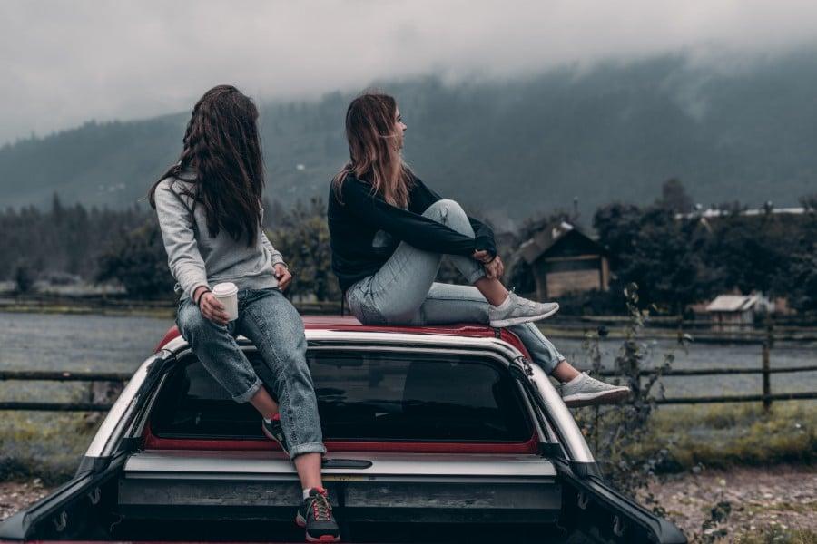 car-insurance-fraud-2-women-sitting-on-top-of-truck