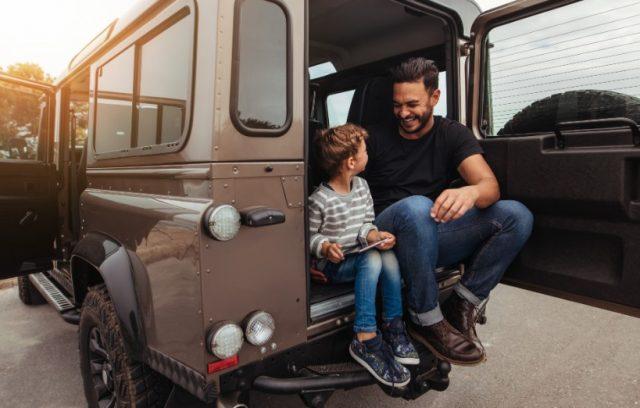 auto-insurance-pink-slip-dad-son-sitting-on-car