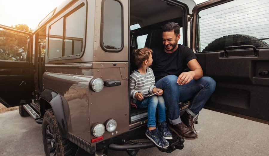 auto-insurance-pink-slip-dad-son-sitting-on-car