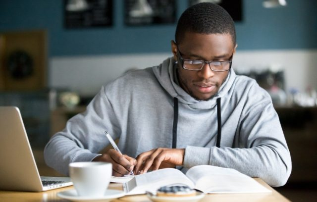 freelancer-how-to-save-man-working-in-cafe-laptop-paper-writing