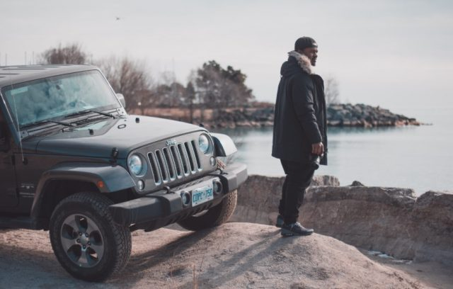 switching-insurance-companies-man-overloooking-water-jeep