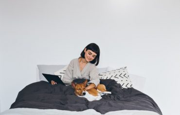 electric-baseboard-heaters-women-under-blankets-with-dog
