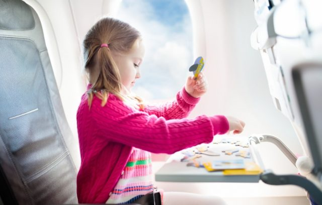 how-to-get-cheap-flights-girl-on-plane