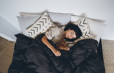 how-to-sleep-well-financially-women-dog-in-bed