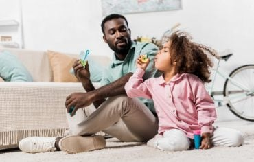 home-insurance-covid-19-father-daughter-blow-bubbles