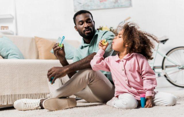 home-insurance-covid-19-father-daughter-blow-bubbles