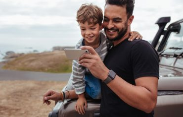 usage-based-insurance-father-son-smartphone