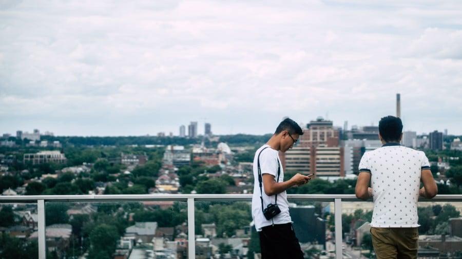 best-toronto-neighbourhoods-2-men-rooftop