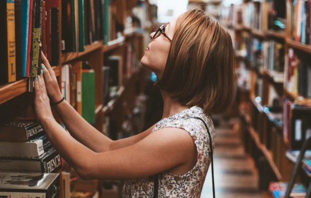 ways-of-financing-education-woman-in-library-browsing-books