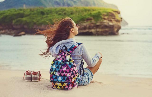 travel-health-insurance-within-canada-woman-sitting-beach