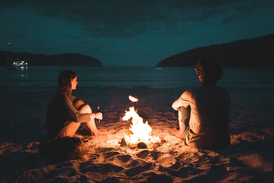 financial-advice-for-couples-beach-fire-lake-mountains