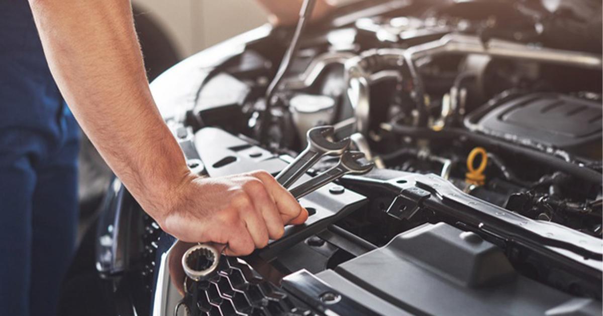 car-mechanic-wrench-engine