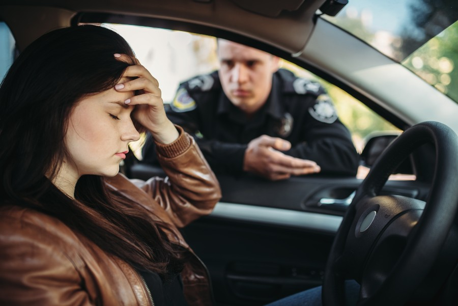 demerit-points-ontario-woman-pulled-pver-in-car-policeman-at-driver-window
