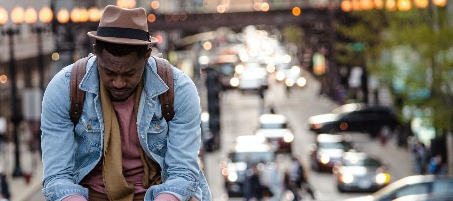 car-insurance-discounts-frustrated-man-sitting-on-bridge