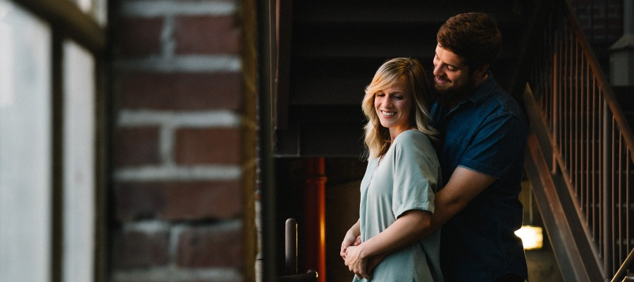 first-year-homeownership-couple-in-home-hugging