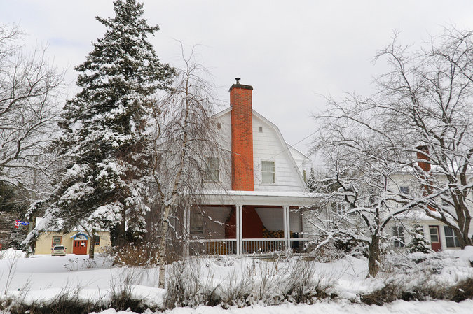 Typical house in winter landscape in Sutton, Quebec, Canada